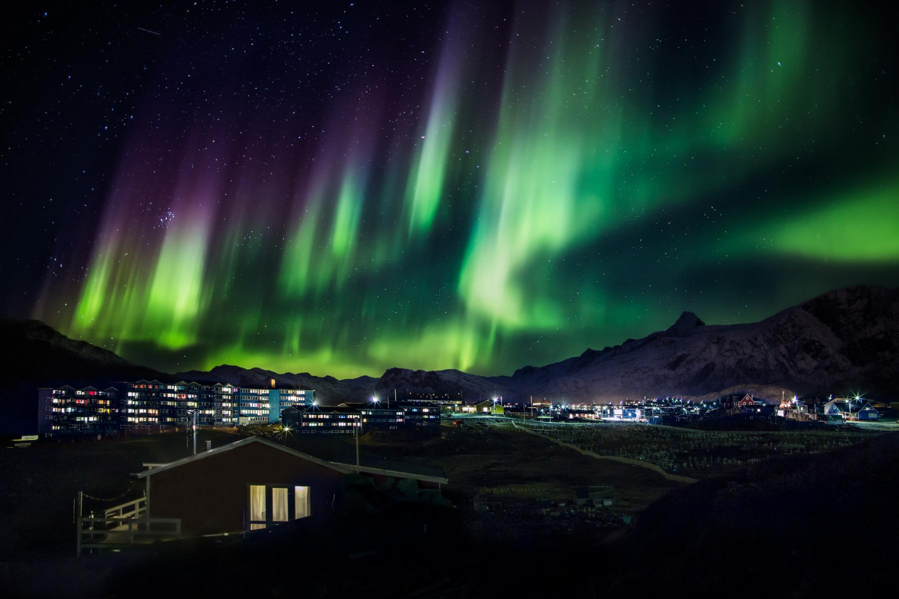 Sleep in igloos, ride on dog sleds under the Greenlandic Northern Lights starting at Kangerlussuaq, Greenland