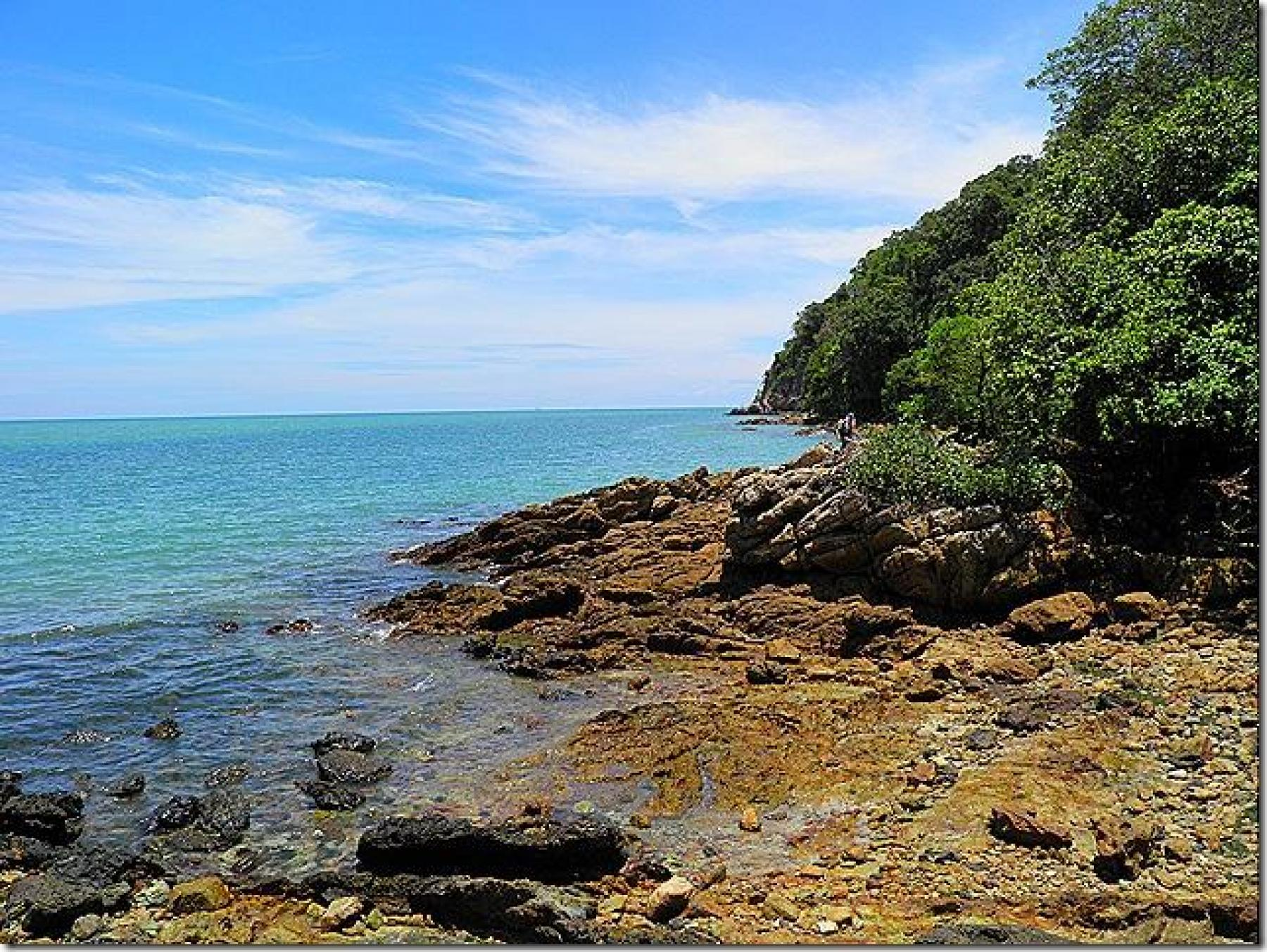 Squeeze'n'slide Pala Rock & discover hidden beaches by the oldest lighthouse starting at Port Dickson Negeri Sembilan Malaysia